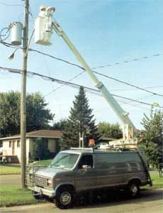 Crane mounted on van.